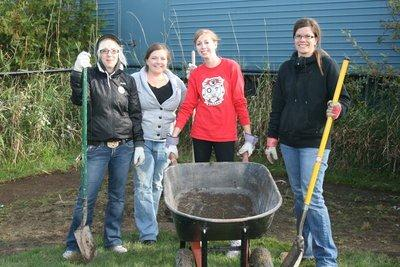 female-volunteers-wheelbarrow